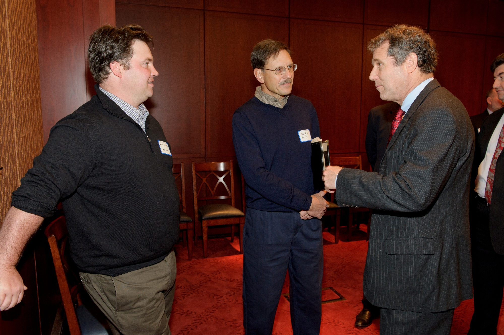 OEFFA members Ron Meyer and Kip Kummerle speaking with Senator Sherrod Brown
